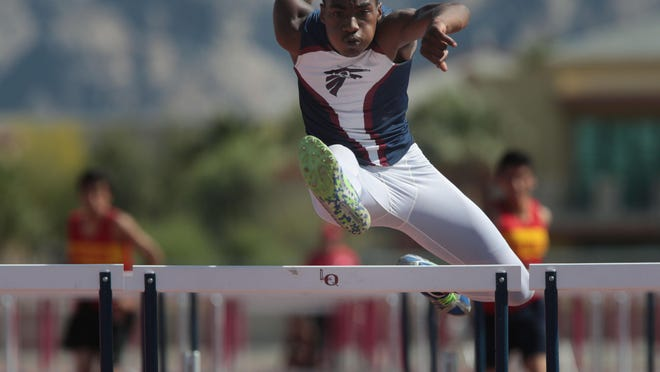 La Quinta's Koty Burton wins the boys' 110 hurdles during a meet against Palm Desert in the spring of 2014. Burton, now a senior, is looking for a state title in the 110 meter hurdles.