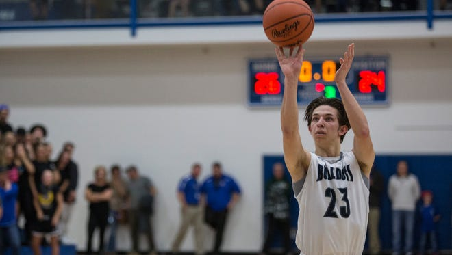 Yale junior Cade Smeznik takes a free throw during a basketball game Wednesday, March 9, 2016 at Cros-Lex High School.
