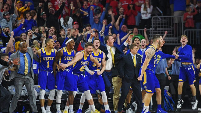 SDSU players celebrate from the bench after teammate Michael Orris (50) scored near the end of a Summit League Tournament semifinal game against USD Monday, March 6, 2017, at the Denny Sanford Premier Center in Sioux Falls. SDSU beat USD 74-71.