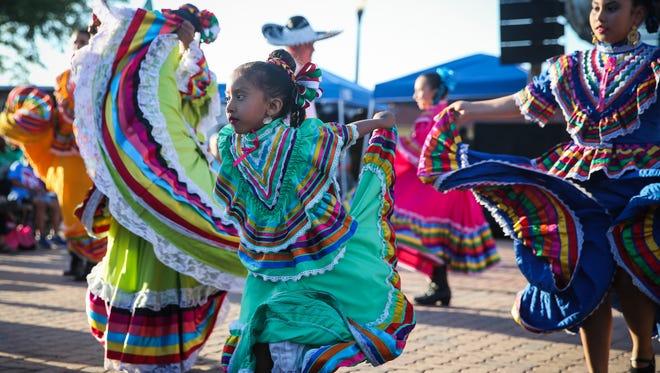 Ballet Folklorico dancers perform during the Cinco de Mayo festival Friday, May 4, 2018, at El Paseo de Santa Angela.