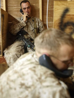 A marine calls home from an unspecified location during deployment in this undated photo.