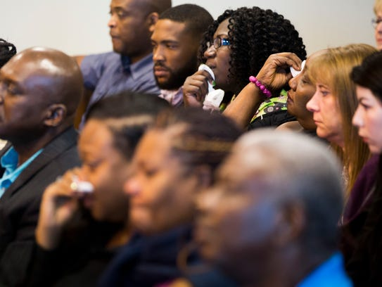 Relatives of the late Guerline Dieu Damas are overcome with grief  Friday, Oct. 27, 2017, during the sentencing hearing for her husband, Mesac Damas, who had pleaded guilty to murdering Guerline and their five children in September 2009 in their North Naples home. Damas was sentenced at the Collier County Government Center in East Naples.
