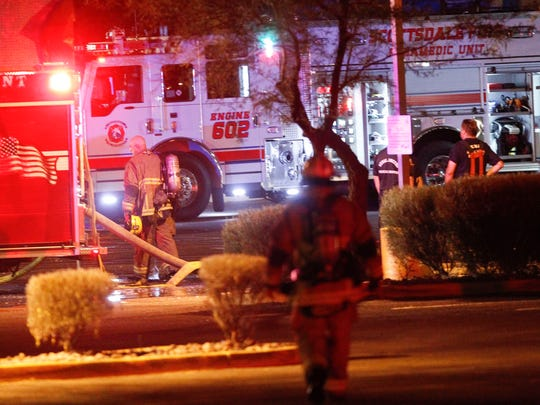 Tempe and Scottsdale firefighters respond to a fire at Big Surf waterpark on Tuesday, May 10, 2016, in Tempe, Ariz.