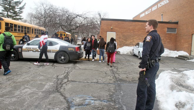 Police were outside Spring Valley High during dismissal Tuesday after a stabbing inside earlier in the day.