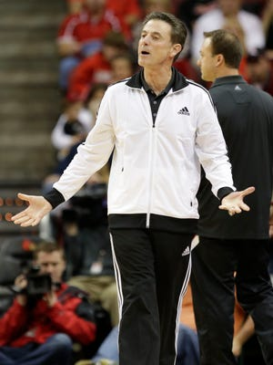 Louisville coach Rick Pitino yells during the scrimmage at the KFC Yum! Center.October 19, 2014