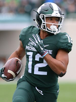 MSU's R.J. Shelton picks up a first down against Purdue at Spartan Stadium on Oct. 3, 2015.