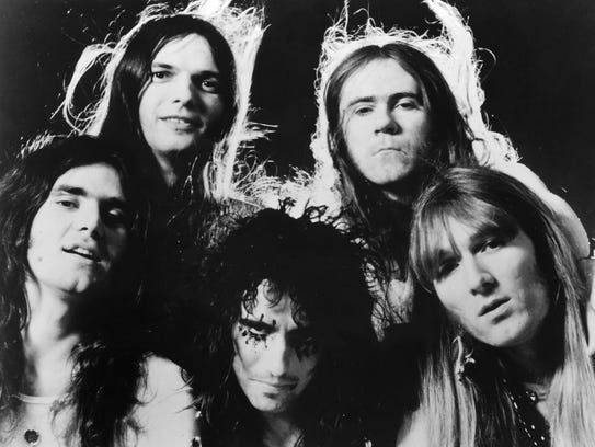 """The original Alice Cooper band, clockwise from bottom center: Alice Cooper, Michael Bruce, Dennis Dunaway, Glen Buxton and Neal Smith. Bruce, Dunaway and Smith joined Cooper on two songs on his latest album, """"Paranormal."""" Buxton died in 1997."""
