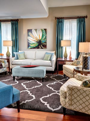 Symmetrical, asymmetrical and radial balance are all illustrated in this attractive living space.