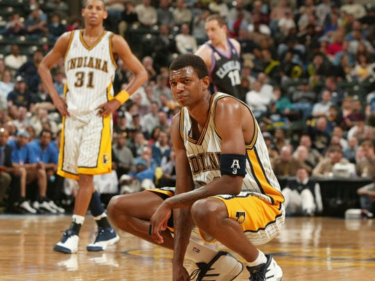 FILE - Pacers forward Jonathan Bender, camps out on the court during a brief break April 8, 2002.