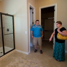 Jimmy and Tiffany Talbert, of Maricopa, look at a Fulton closeout home at Peninsula at Freeman Farms in Gilbert on Aug. 9, 2014. The couple recently sold their home in Maricopa.