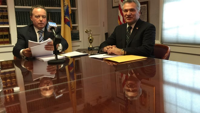 Ocean County Freeholder Joseph H. Vicari (right) and his attorney Robert C. Shea, speak with reporters at a news conference in Toms River on Nov. 21, 2014.