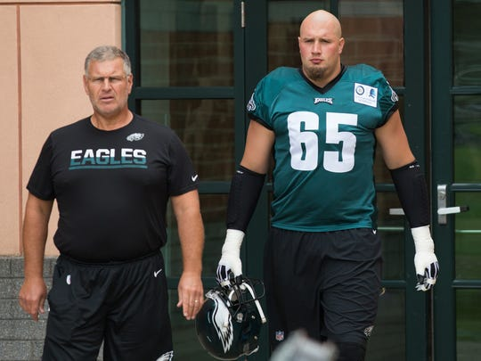 Eagles offensive line coach Jeff Stoutland, left,  walks with tackle Lane Johnson during last summer's training camp. Stoutland's helped Timber Creek coach Rob Hinson find some exciting opportunities in coaching.