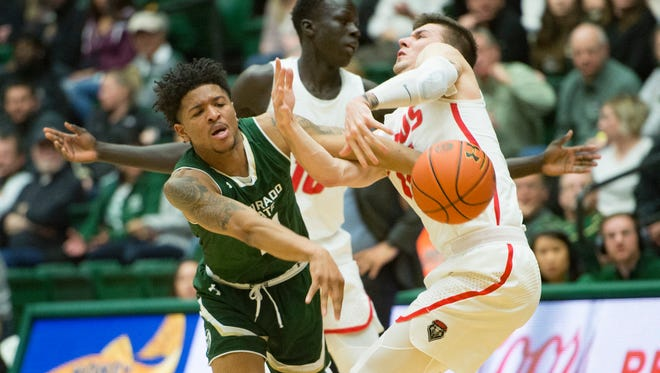 CSU guard Prentiss Nixon loses control of the ball after being mobbed by New Mexico defenders Makauch Maluach and Dane Kuiper during a game at Moby Arena on Wednesday, February 28, 2018 in Fort Collins, Colorado.