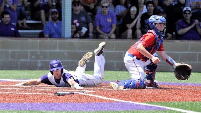 Wylie shortstop Gatlin Martin (21) reaches for home plate to score one of his two runs in the Bulldogs' 12-8 win against Graham in Game 2 of the Region I-4A bi-district series at Bulldog Field on Saturday, May 5, 2018. Wylie won Game 3, 9-5.