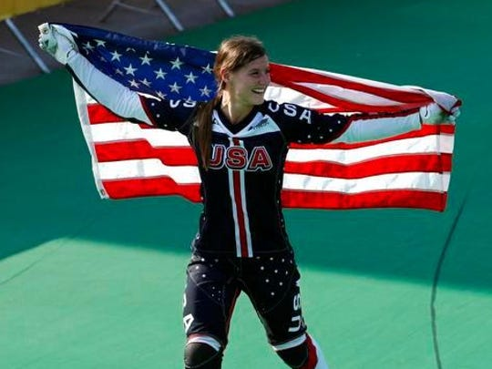 Alise Post celebrates after winning the silver medal in women's BMX at the Olympics last month in Rio de Janeiro. She is back in her hometown this week in advance of her annual MS Race for the Cure event and a parade in her honor this weekend.