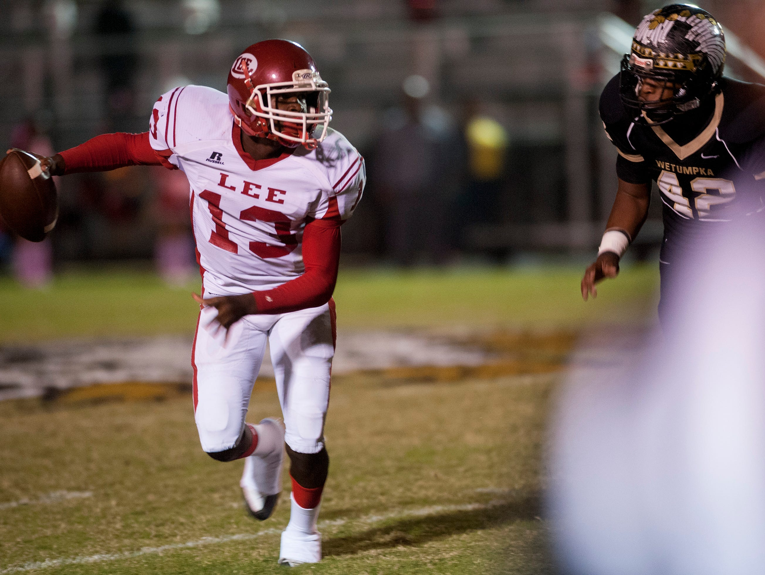 Lee quarterback Shaquille Johnson (13) looks to pass against Wetumpka's Travarris Bozeman (42) at Hohenberg Field in Wetumpka, Ala. on Friday October 30, 2015. (Mickey Welsh / Montgomery Advertiser)