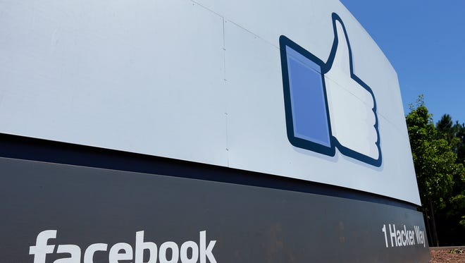 This Tuesday, July 16, 2013, file photo, shows a sign at Facebook's headquarters in Menlo Park, Calif.