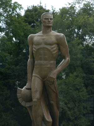 The bronze Sparty statue mounted on campus at MSU.