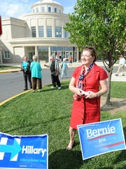 Patriotically dressed Christine Macysyn of Lewes passes out cards supporting Mark Schaffer, a candidate for Sussex County Council, as voters came out in a steady stream on Tuesday afternoon, April 26, to vote in the primary at Cape Henlopen High School near Lewes.