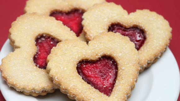 These heart-shaped Linzer cookies are just one of many options customers have in la Madeleine bakery-cafes. When a customer buys a cookie during the month of May, la Madeleine will donate $1 to children in need through the Children's Hunger Fund.