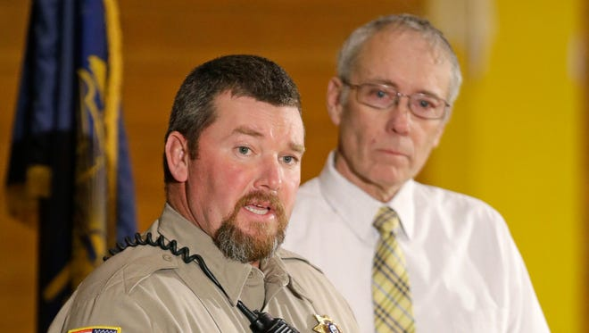 Harney County Sheriff David Ward, left, speaks to the media as Judge Steven Grasty looks on, Monday, Jan. 4, 2016, in Burns, Ore.