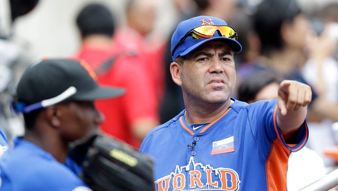Edgardo Alfonzo points before the MLB All-Star Futures baseball game in Citi Field in 2013. Alfonzo managed the World team against  the U.S. team.