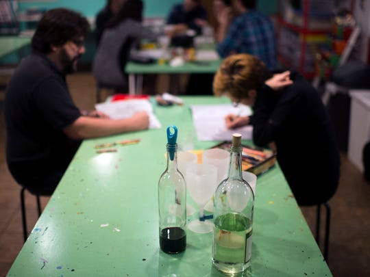 McArt a la Carte hosts an adult coloring night complete with snacks, beer and wine in Woodbury.