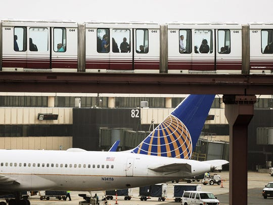 General view of United Airlines planes at Terminal C in Newark Liberty International Airport as the monorail passes overhead. United Airlines will cease flights to the West Coast from John F. Kennedy International Airport and shift them to Newark Liberty International Airport in response to customer preferences, the airline said Tuesday, November 29, 2014.