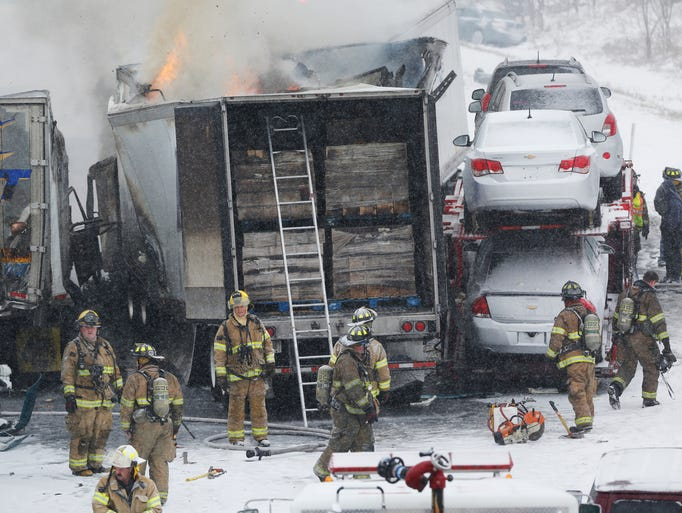 Firefighters and police respond following a multiple-vehicle accident in the northbound lane of I-65 just north of Eisenhower Road  Saturday, January 18, 2014, in Lafayette. A box truck caught fire in the accident. Numerous slide offs also took place in the immediate area and traffic in both lanes backed up heavily.