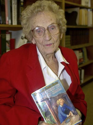 """Mildred Wirt Benson holds one of the """"Nancy Drew"""" mystery books in Toledo in 2011. Benson wrote more than 130 books, including the 1940s Penny Parker mystery series. She is best known for creating Nancy Drew."""