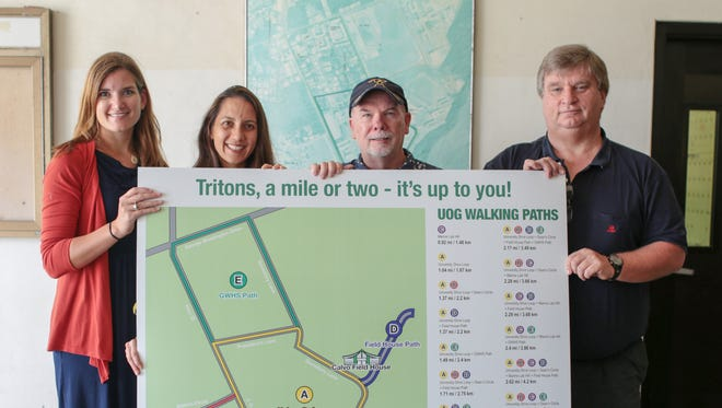University of Guam officials show the new walking/running map for the campus. From left: Emily Shipp; Tanisha Aflague, assistant professor of nutrition; Jim Hollyer, associate dean for research and extension at the College of Natural and Applied Sciences; and UOG Athletic Director Doug Palmer.
