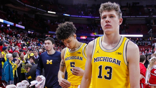 Michigan's D.J. Wilson (5) and Moritz Wagner (13) walk off the court after the team's 68-64 loss to Wisconsin in an NCAA college basketball game U-M's 68-64 loss to Wisconsin Tuesday in Madison, Wis.