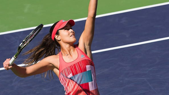 Ana Ivanovic of Serbia serves to Czech player Karolina