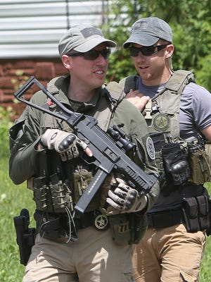 Law enforcement officers from several different agencies continue an intensive search for Richard Matt, and David Sweat,  near the maximum-security Clinton Correctional Facility in Dannemora, N.Y.,  June 14, 2015.