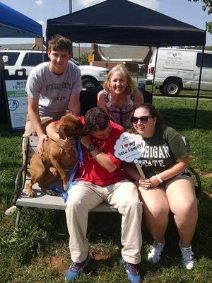 Bella, a 2 1/2-year-old dog, was adopted by her family during the Clear the Shelters pet adoption drive day.