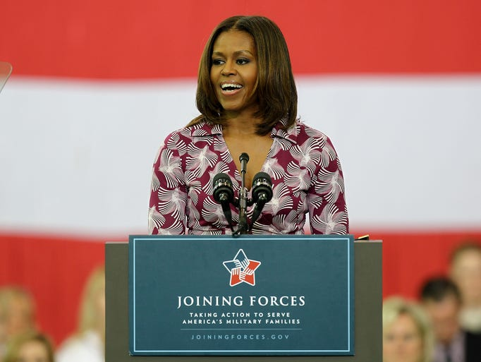 Michelle Obama smiles as she speaks at the Ft. Campbell Veterans Jobs Summit and Career Forum. April 23, 2014
