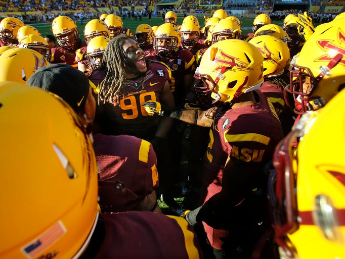 Will Sutton rallies his Sun Devil teammates during halftime of a game on Oct. 19, 2013, in Tempe.