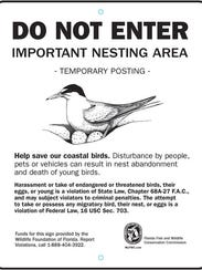 This is a sign along the Navarre Beach Causeway notifying