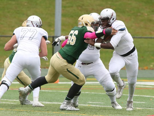 From 2017: Howard Cross III (green No. 56) is a standout in the St. Joseph Green Knights defense.