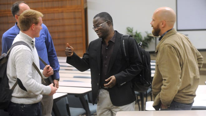 John Azumah, center, visits with a student after speaking on Christianity and Islam at Abilene Christian University Wednesday. Azumah was guest speaker for the two-day  Broom Colloquium at ACU.