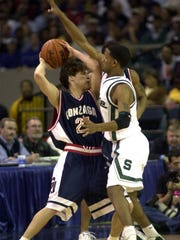 Charlie Bell, shown here guarding Gonzaga's Dan Dickau during their 2001 NCAA tournament game, had a double-double to help the Spartans win and advance to the Elite Eight.