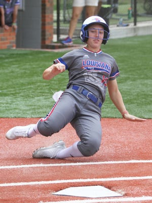 Former North DeSoto standout Bayli Simon slides into home for Louisiana Tech.