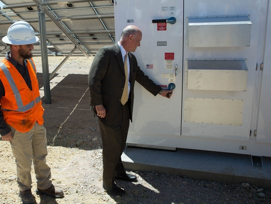 City Manager Stuart Ed turns the switch on the new