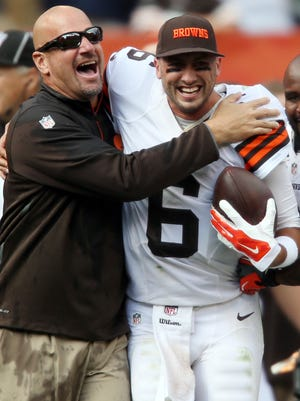 Cleveland Browns head coach Mike Pettine celebrates with quarterback Brian Hoyer (6) after beating New Orleans Saints 26-24 at FirstEnergy Stadium.