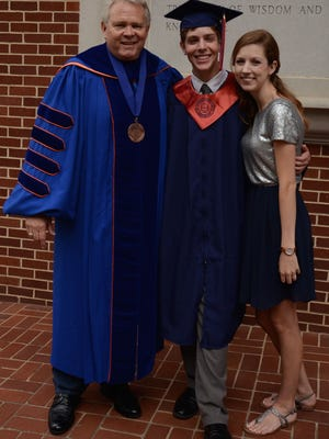 Town Talk reporter Miranda Quartemont (right) poses with her fiancé, Mark Klein, (middle) and Louisiana College President Rick Brewer (left) before Louisiana College's 158th commencement. Klein graduated on Saturday with honors and a degree in Convergence Media.
