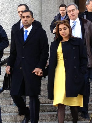 Former SAC Capital portfolio manager Mathew Martoma, left, shown leaving Manhattan federal court in New York City with his wife, Rosemary, after his 2014 convictioin on insider-trading charges.