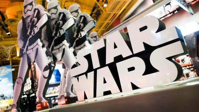 A view of a display of 'Star Wars' toys in a Toys R Us store in New York. The next movie in the popular series, 'Star Wars: The Force Awakens', is set to be released in December 2015 and there are many product tie-ins being marketed to consumers.