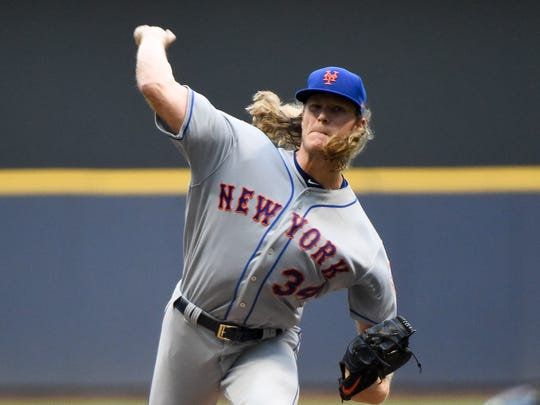 New York Mets pitcher Noah Syndergaard (34) throws a pitch in the first inning against the Milwaukee Brewers at Miller Park.
