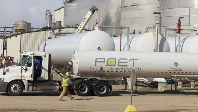 A construction worker walks by a truck at the POET Biorefining plant on Hillman-Ford Road. The South Dakota-based biofuel company announced in 2017 it was spending $120 million to expand the Marion facility.