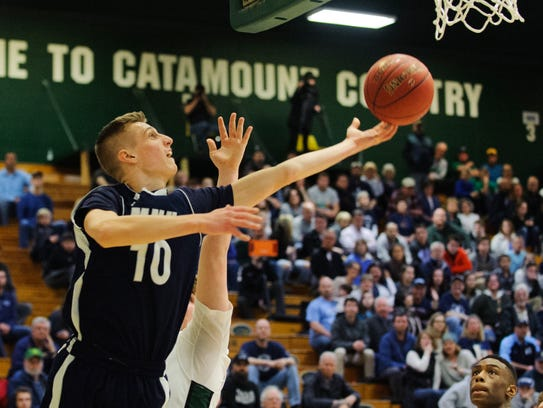 MMU's Zach Reinhardt (10) leaps for a lay up during